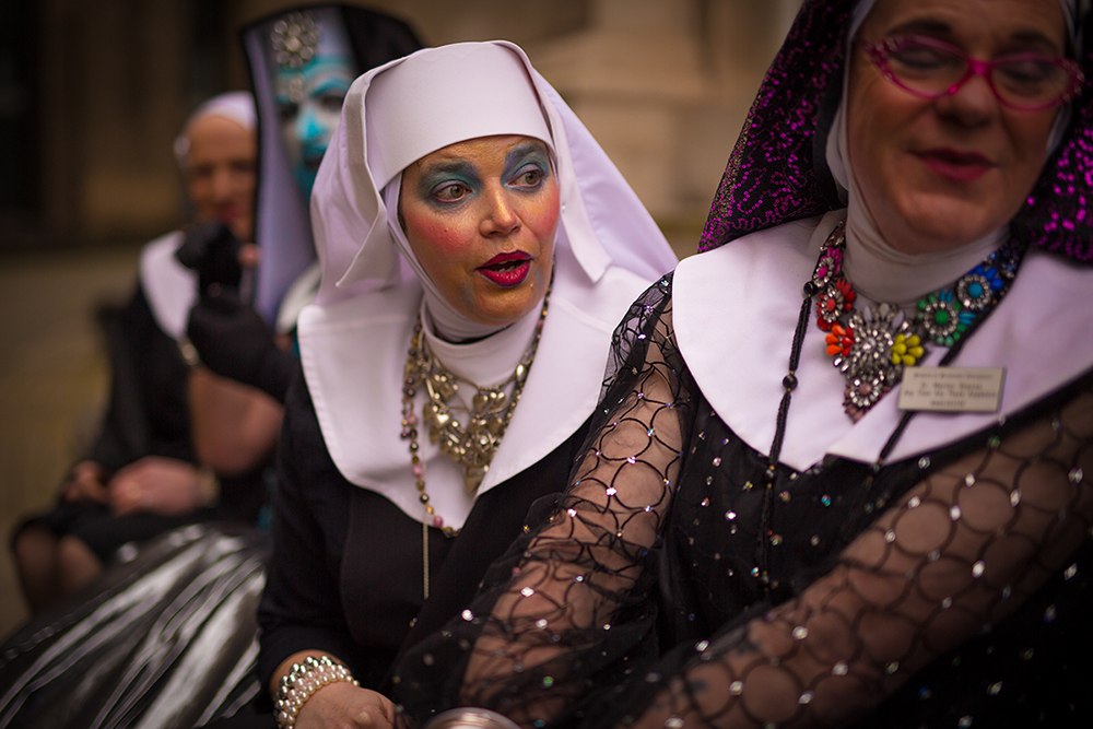 Sister Polly and Sister Martini looking at the Manchester Sisters calendar