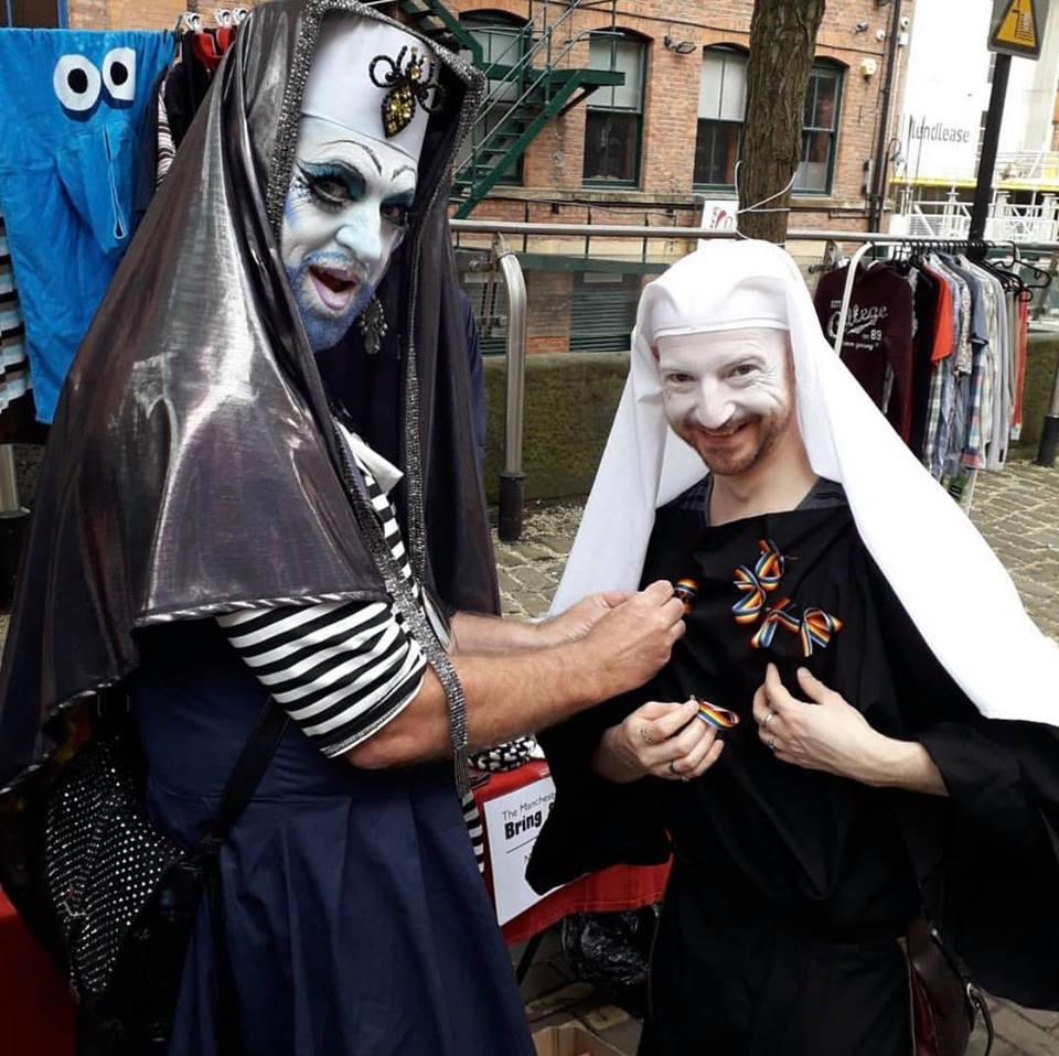 Sister BangBang pinning ribbons onto Postulant Mona
